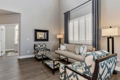 Plantation Shutters & Custom Drapes Throughout