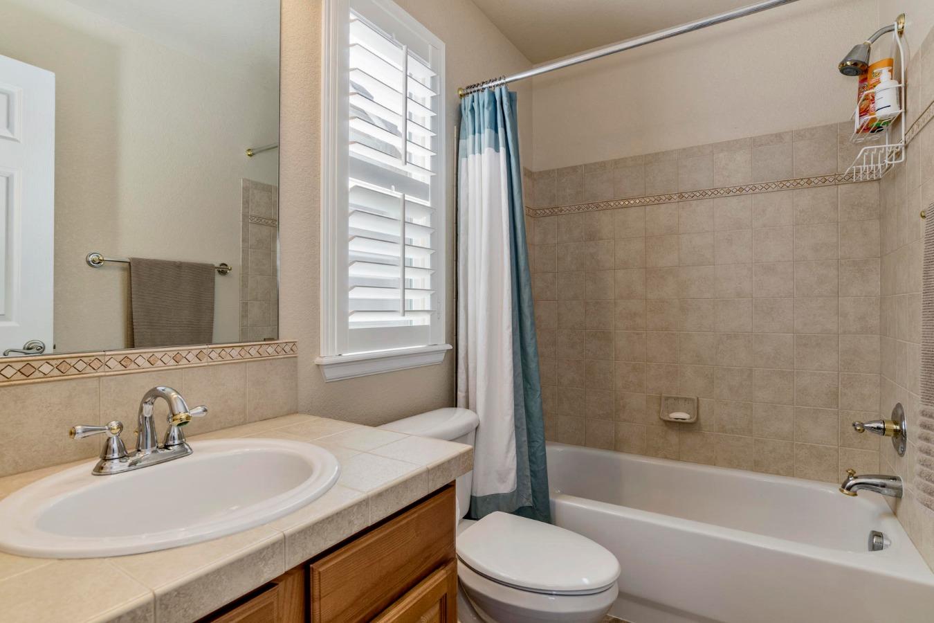 En-suite Full Bath in Bedroom #2 is Tiled
