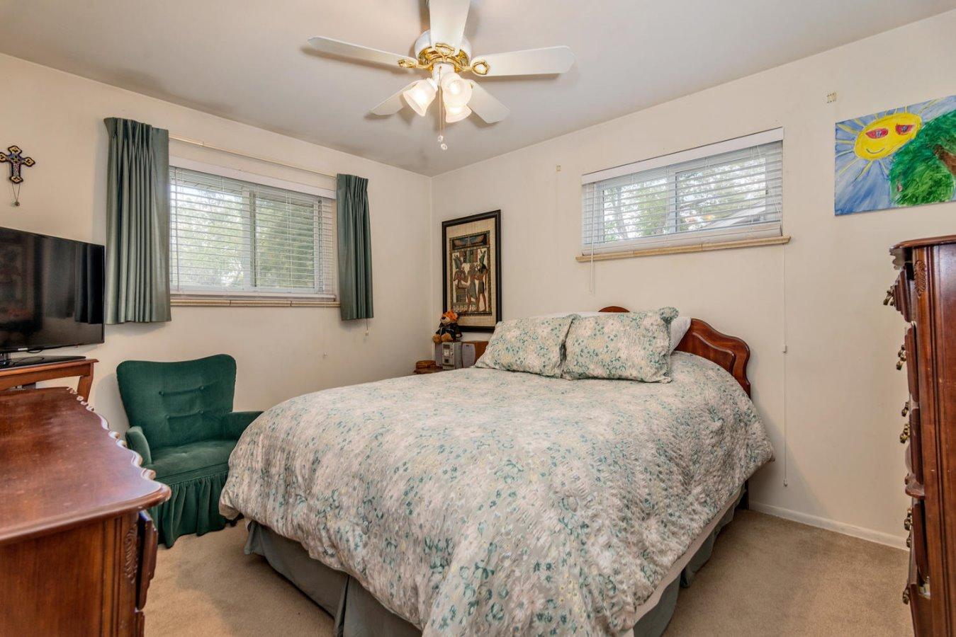 Master Bedroom with Ceiling Fan & Vinyl Windows