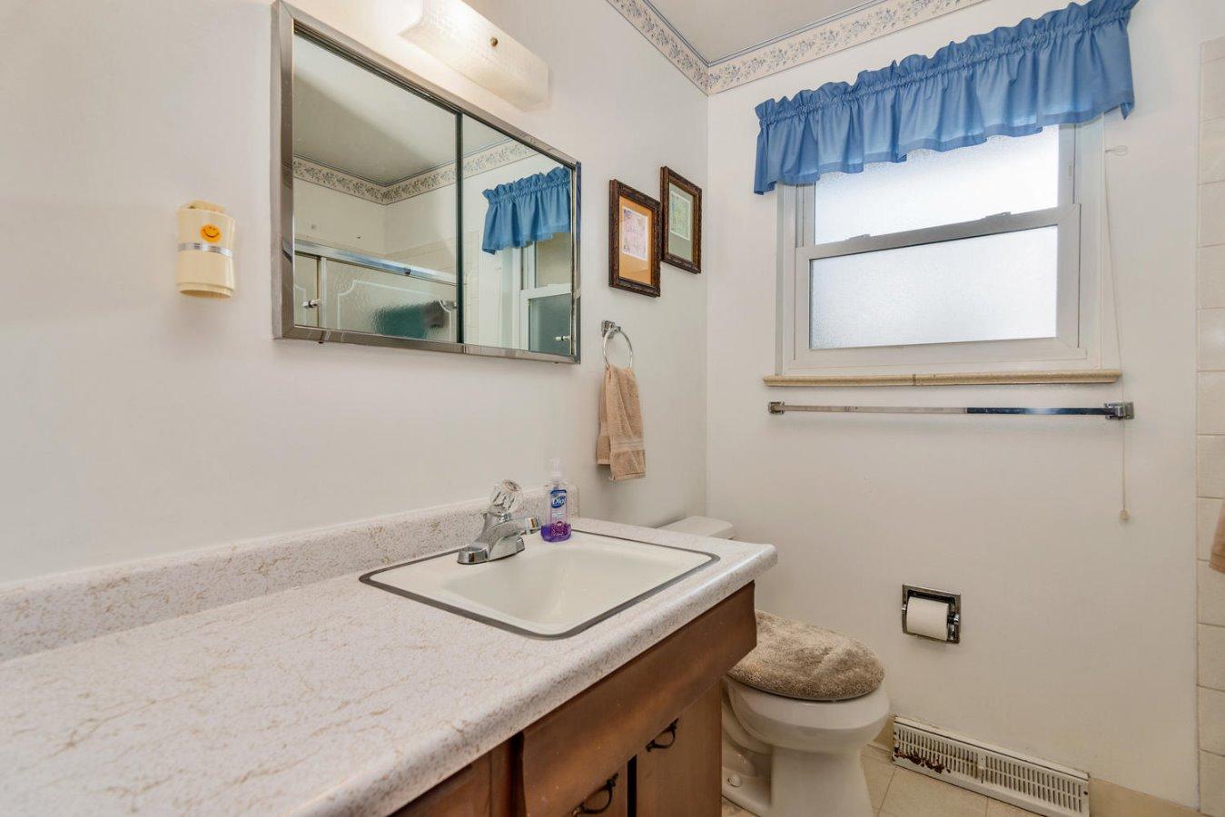 Full Bath on Main Floor + 3/4 Bath in Basement