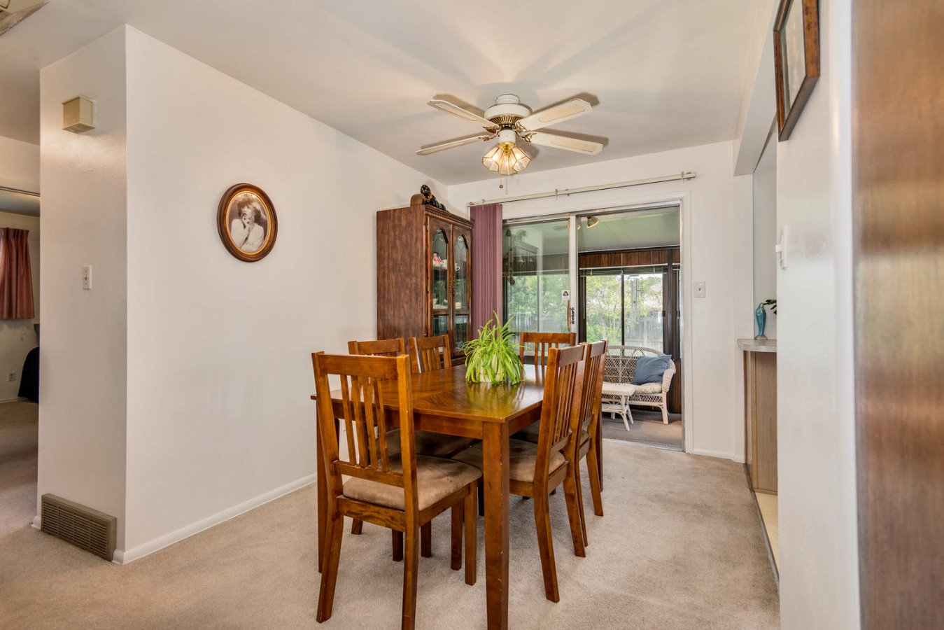 Dining Room Opens to Kitchen & Enclosed Sun Room