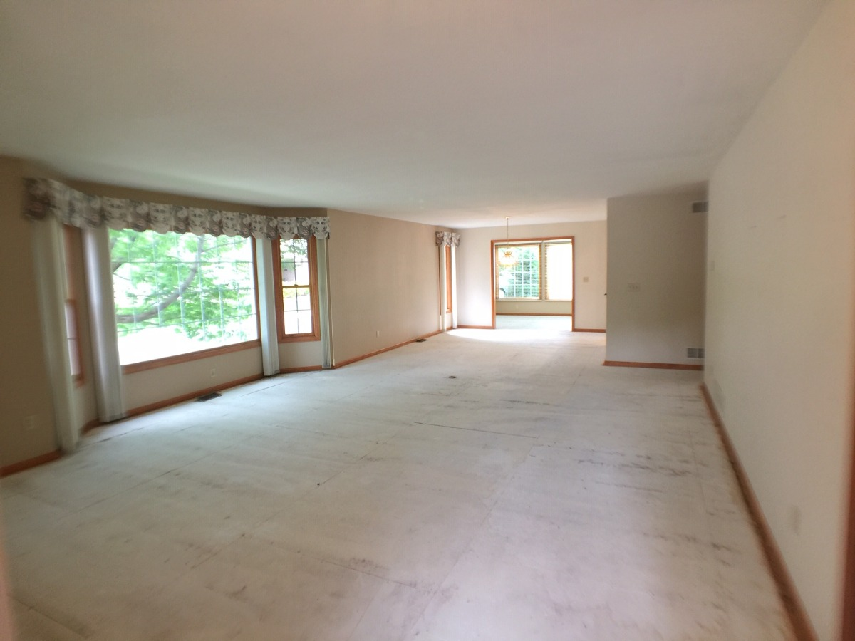 Open Views of Living Room &  Formal Dining Room