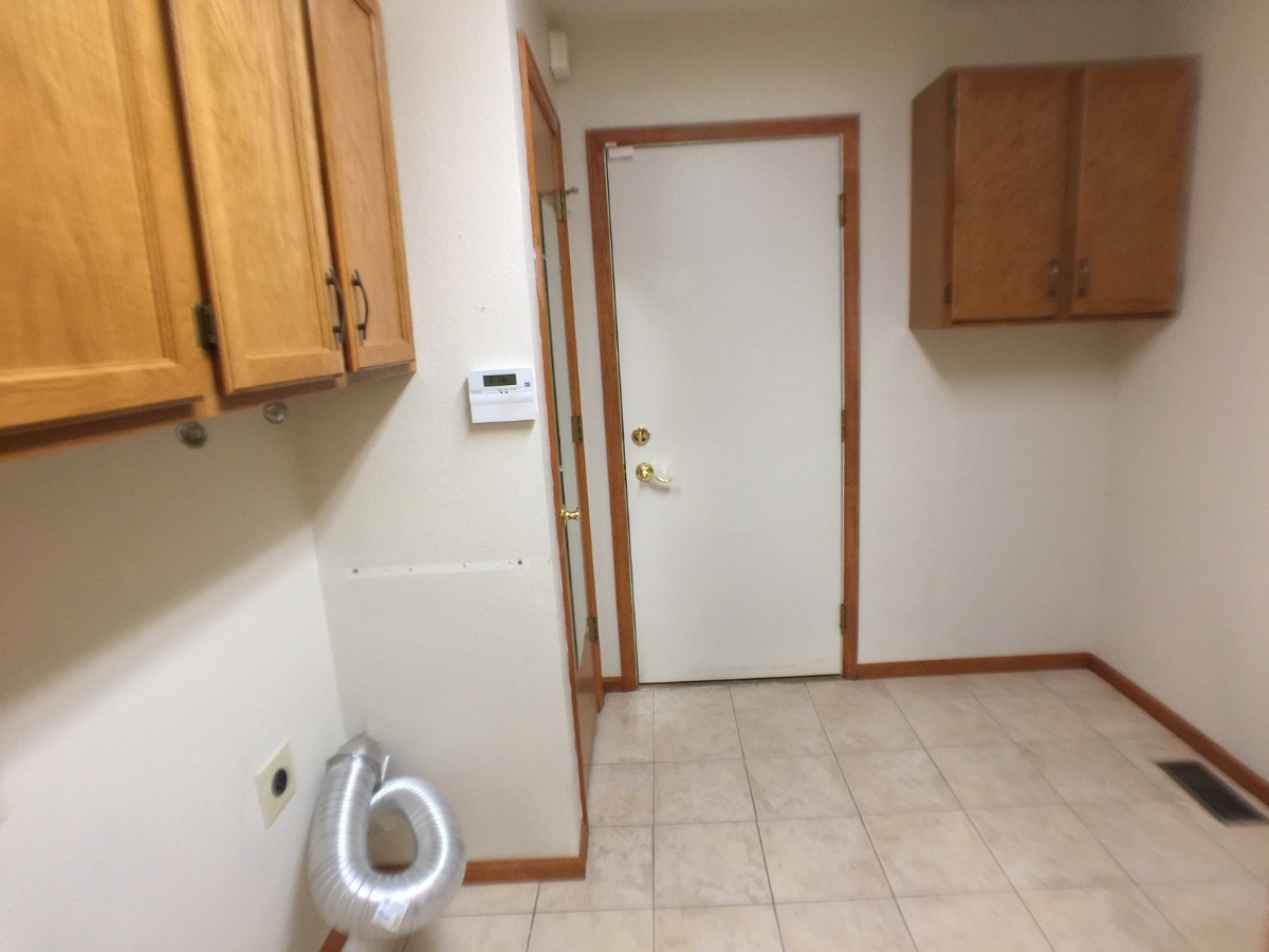 Extra Large Main Floor Laundry w/Storage Cabinetry
