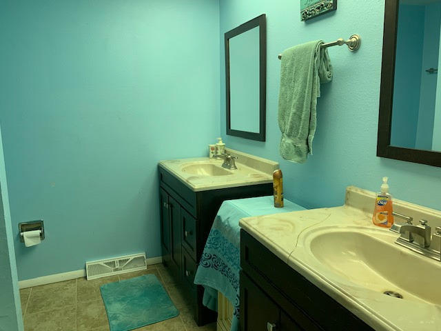 Full Hall Bath with Tile Floor for Bedrooms