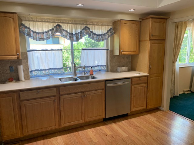 New Cabinetry with Solid Surface Counters