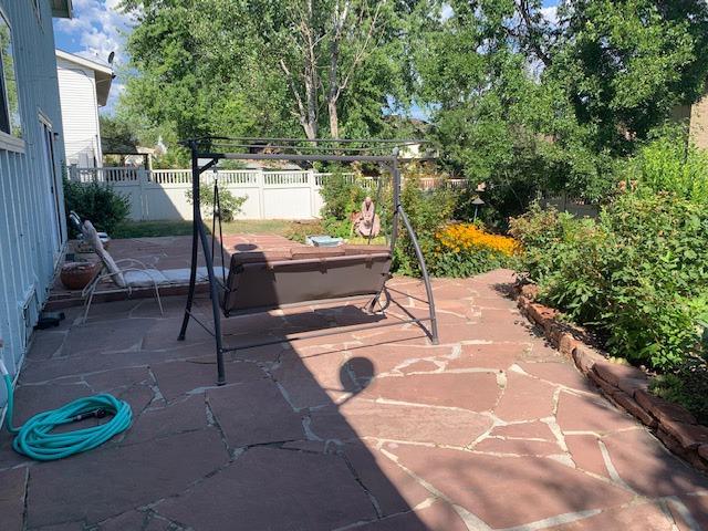 Large Patio Overlooks Park-Like Backyard
