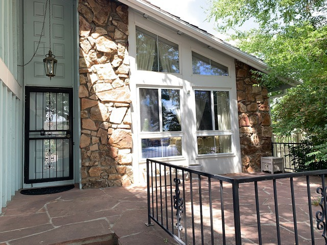 Welcoming Front Entrance + Newer Vinyl Windows