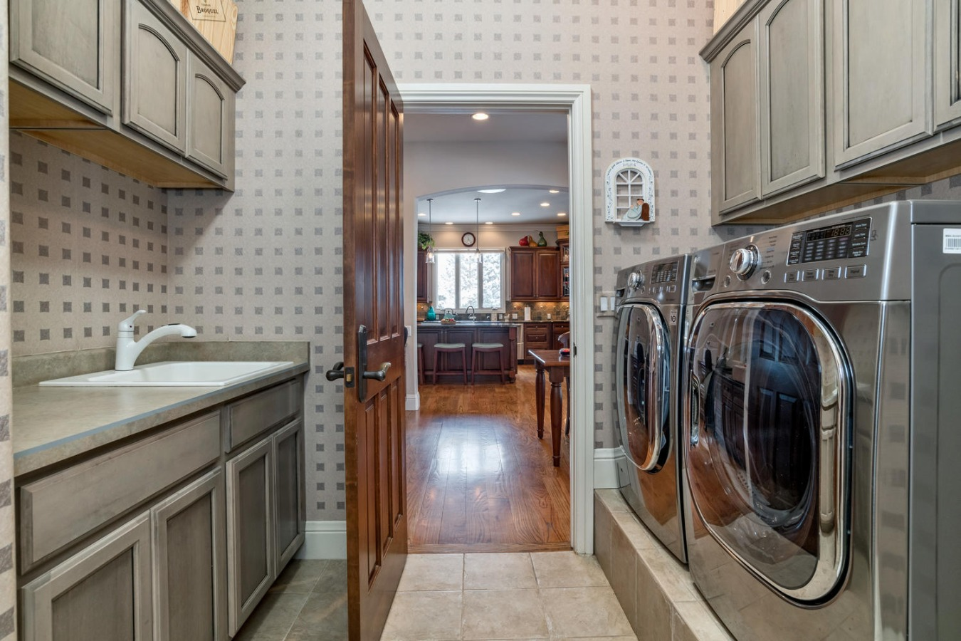 Spacious Laundry Room with Utility Sink & Storage
