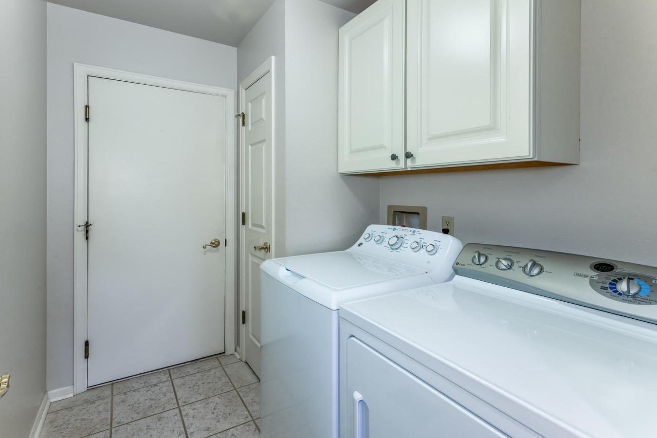 Main Floor Laundry with Storage