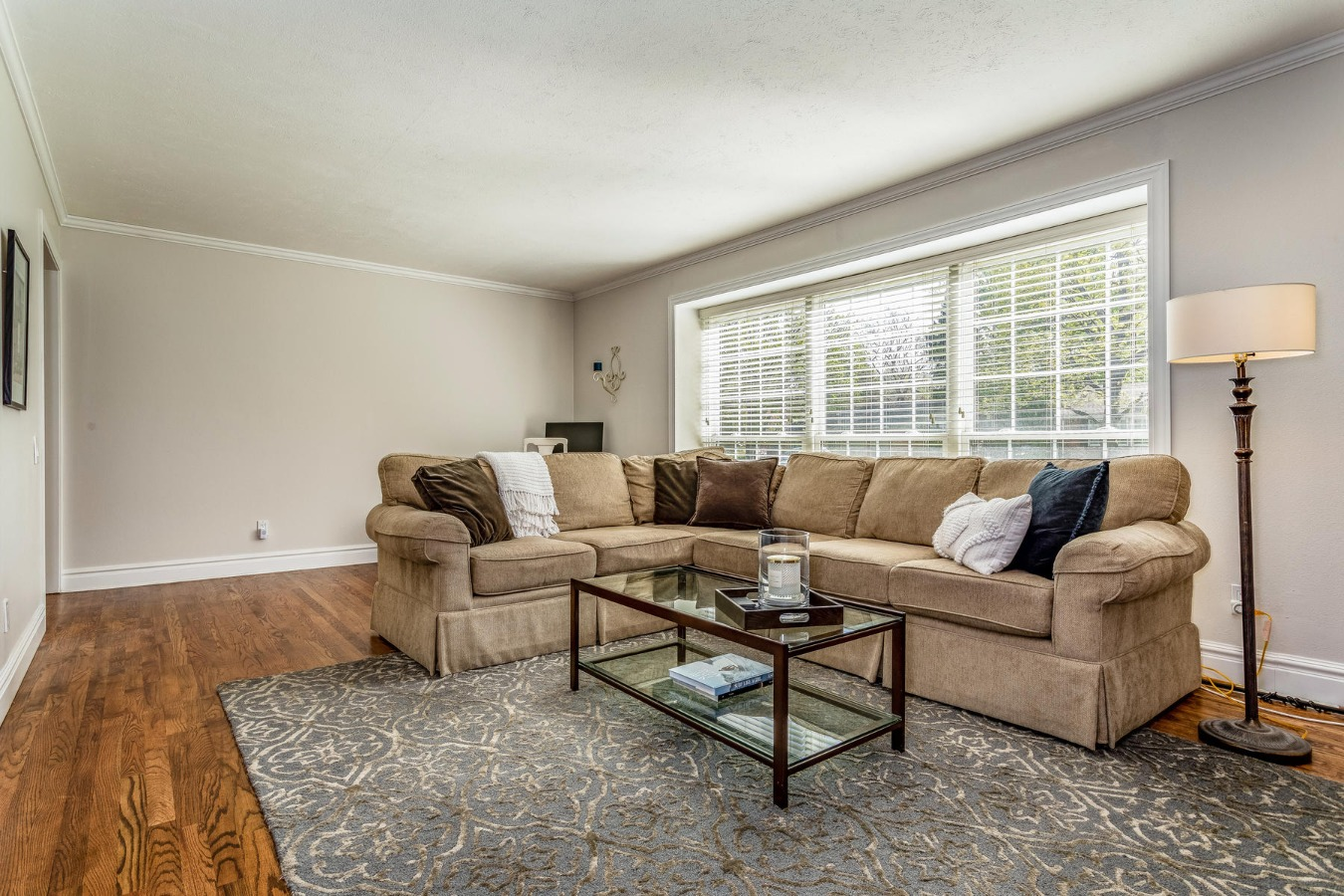 Spacious Living Room Features Crown Molding