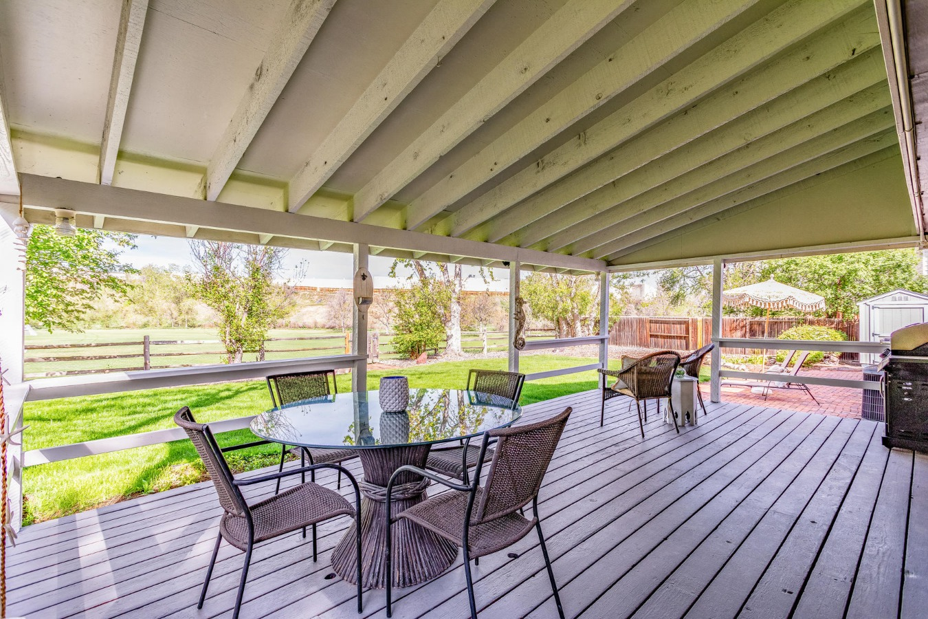 Huge Covered Deck Steps Out from Kitchen