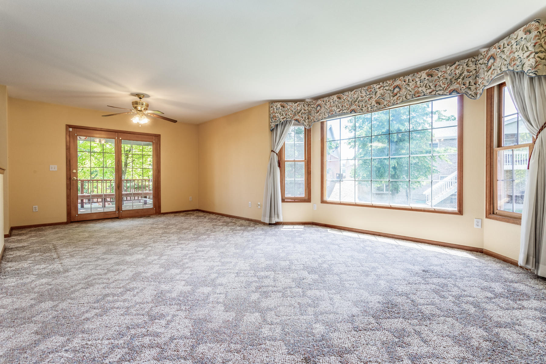 Large Living & Formal Dining Area with Bay Windows