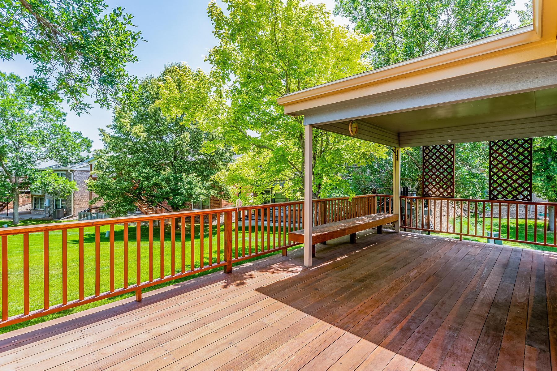 Huge Back Deck Overlooks Greenbelt Behind Home