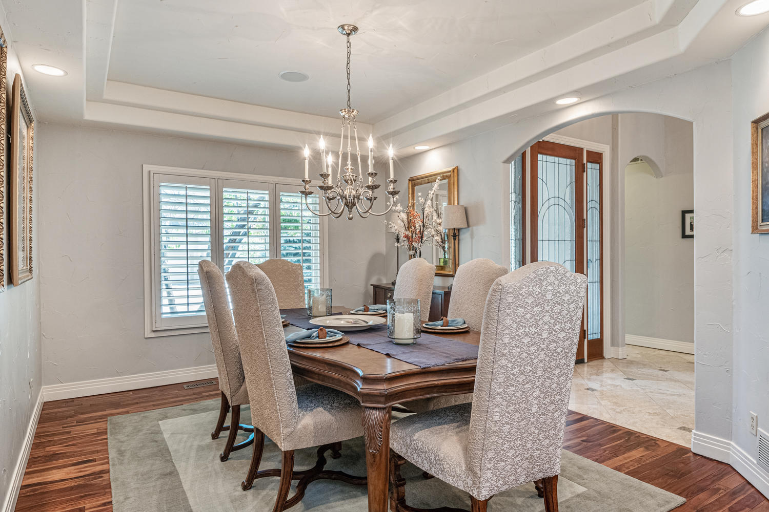 Spacious Open Formal Dining Room with Tray Ceiling