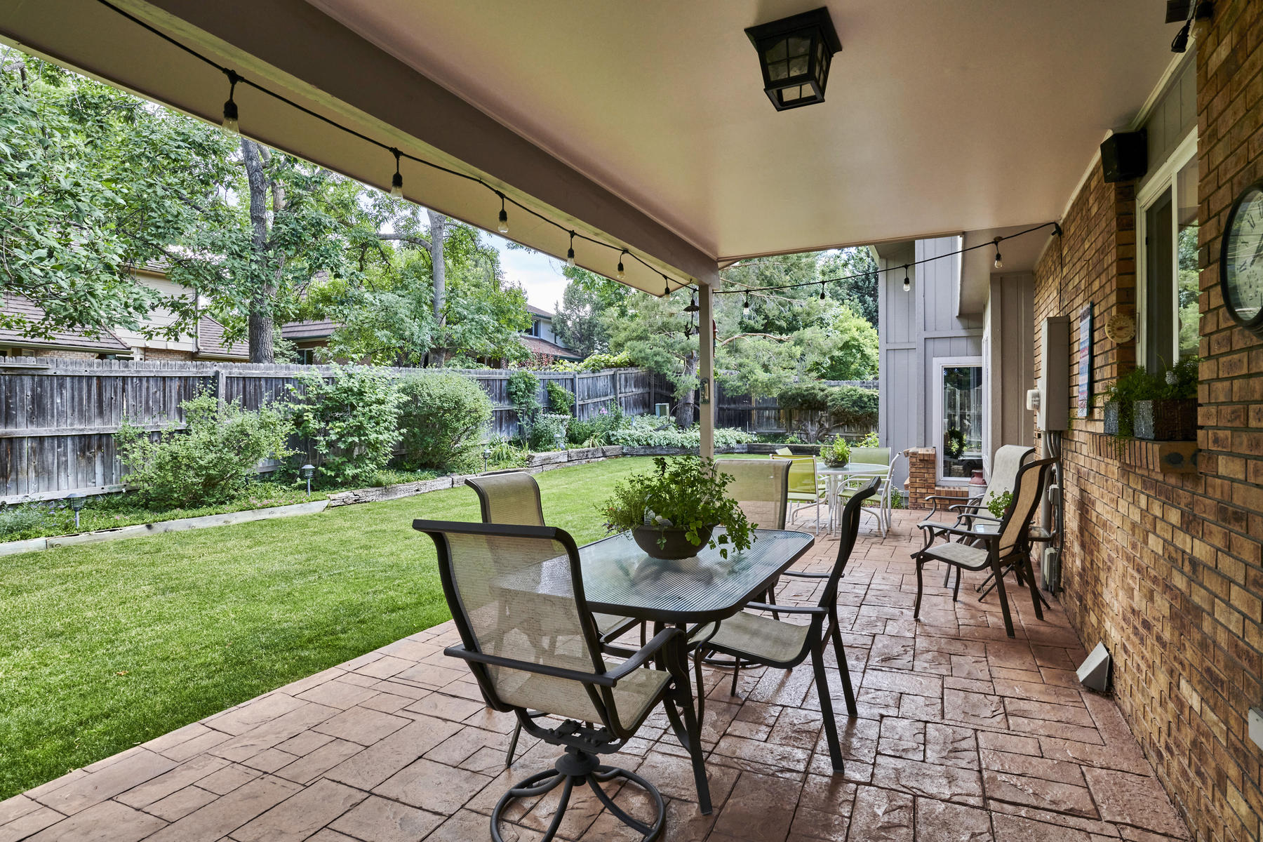 Step out to the Covered Patio Area from Kitchen