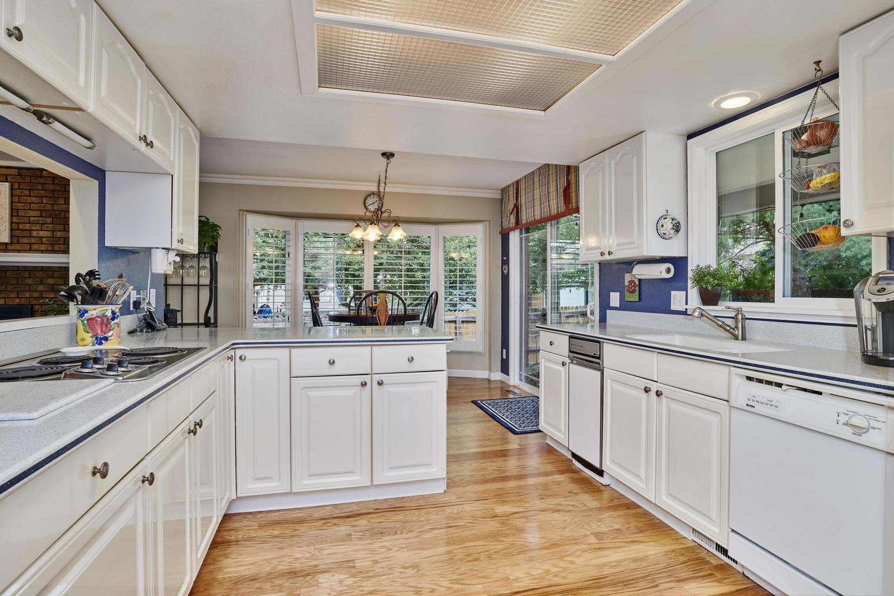 Abundant Kitchen Cabinetry+Solid Surface Counters