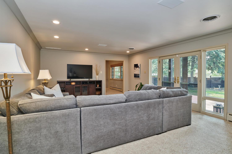 Living Room Overlooks Tranquil Backyard & Patio