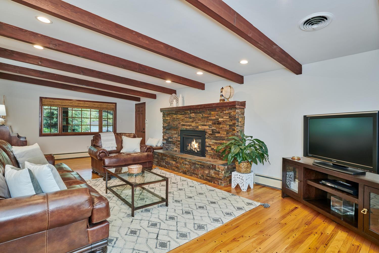 Neat Main Floor Family Room w/Stacked Stone Hearth