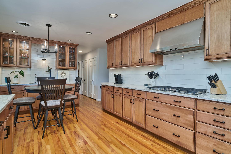 Abundant Cabinetry & Hardwood Floors in Kitchen