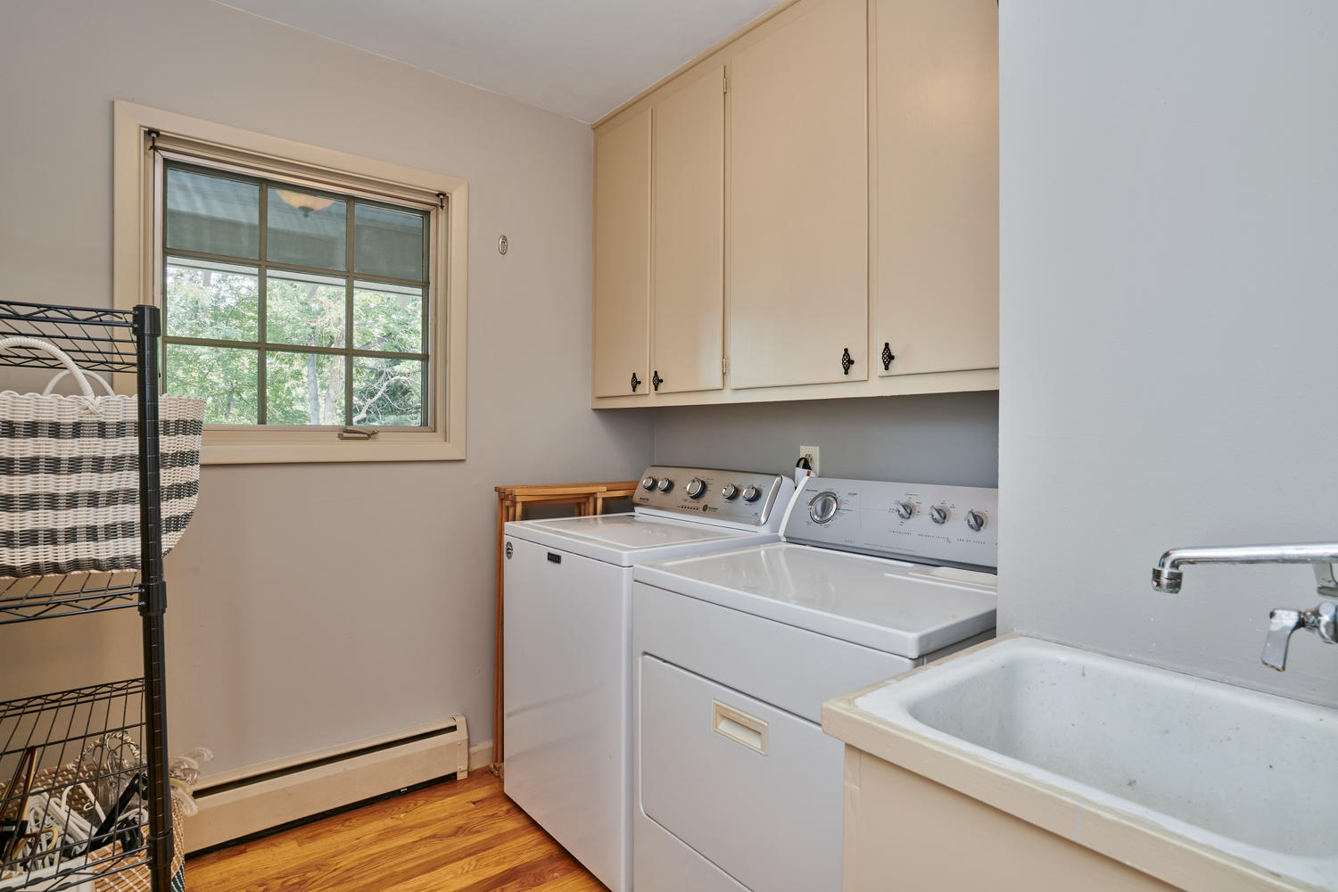 Main Floor Laundry with Storage & Utility Sink