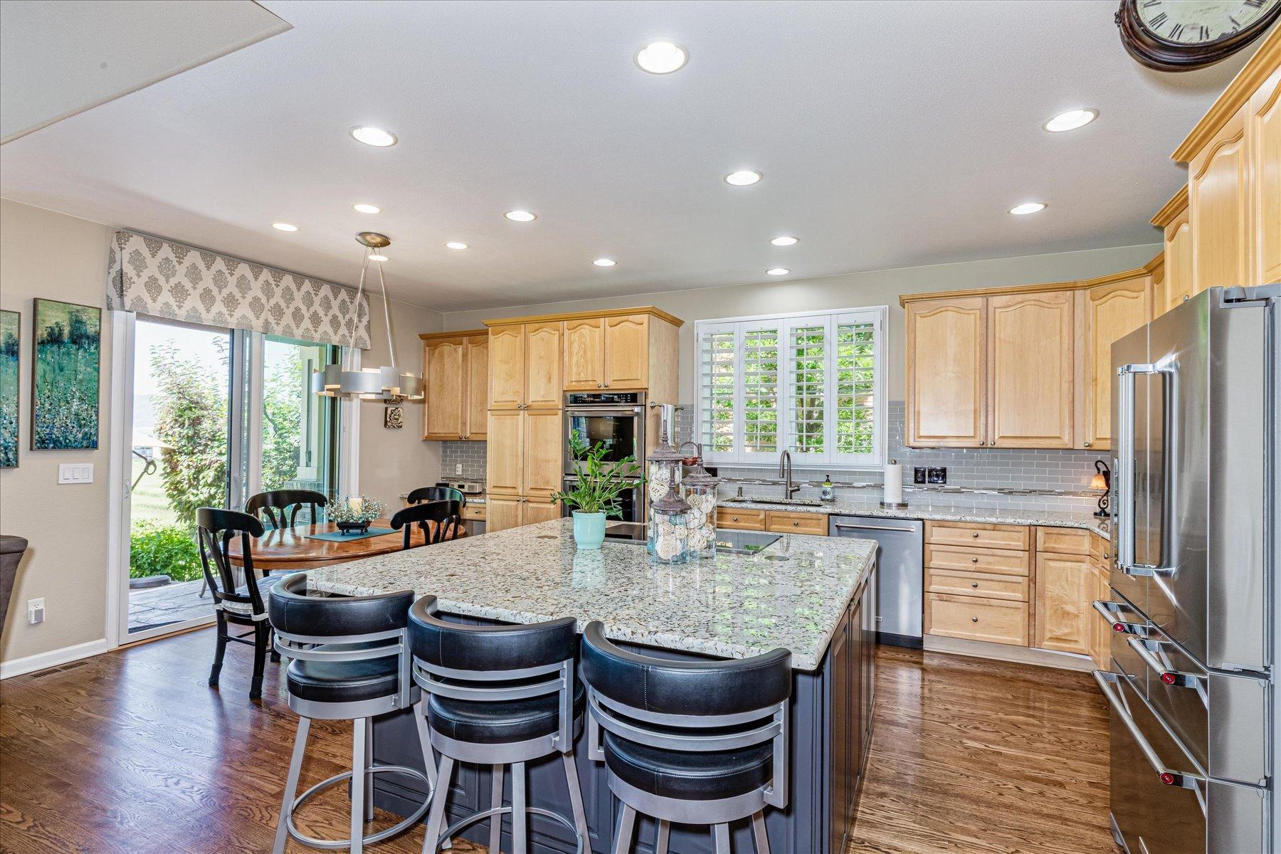 Kitchen Remodel Features Large Slab Granite Island