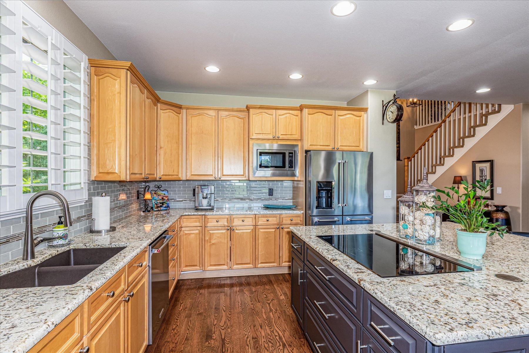 Abundant Maple Cabinetry with Slab Granite