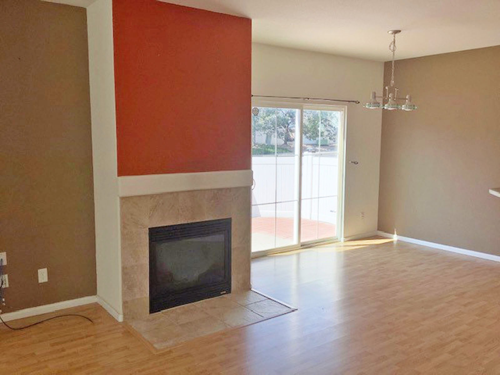 Gas Fireplace & Slider to Large Patio Area
