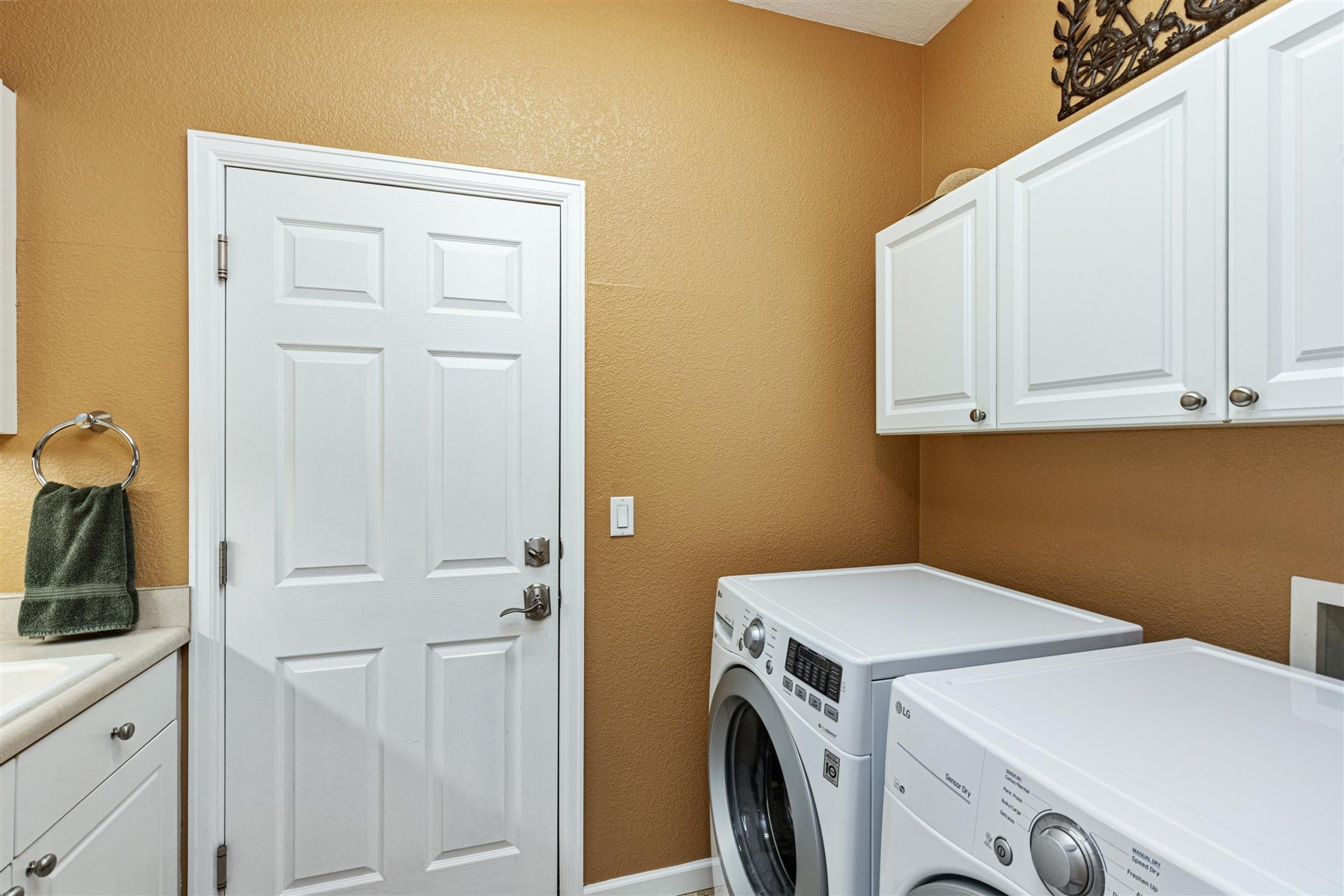 Laundry Room with Utility Sink & Cabinetry