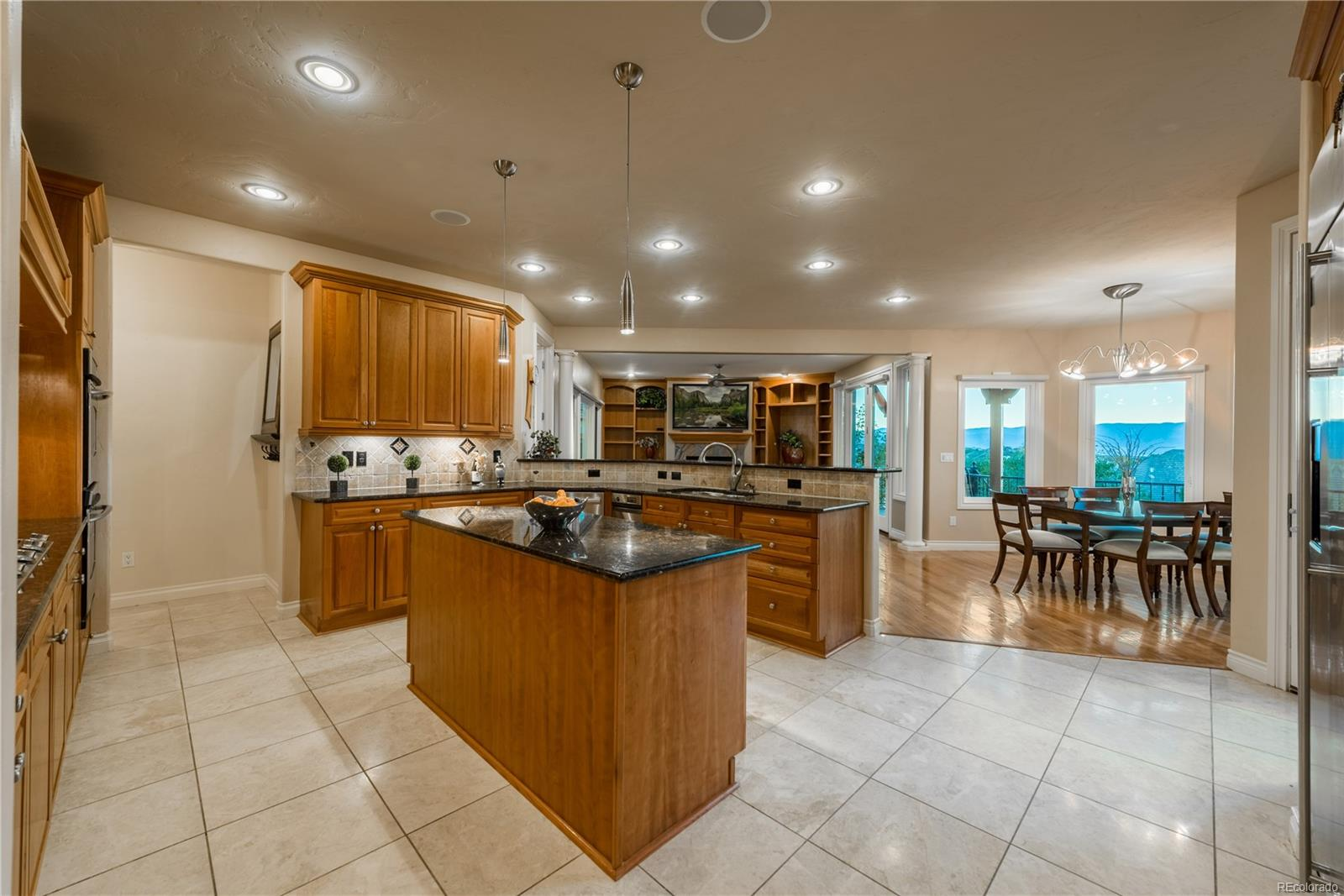Kitchen is open to nook area and family room with beautiful views.