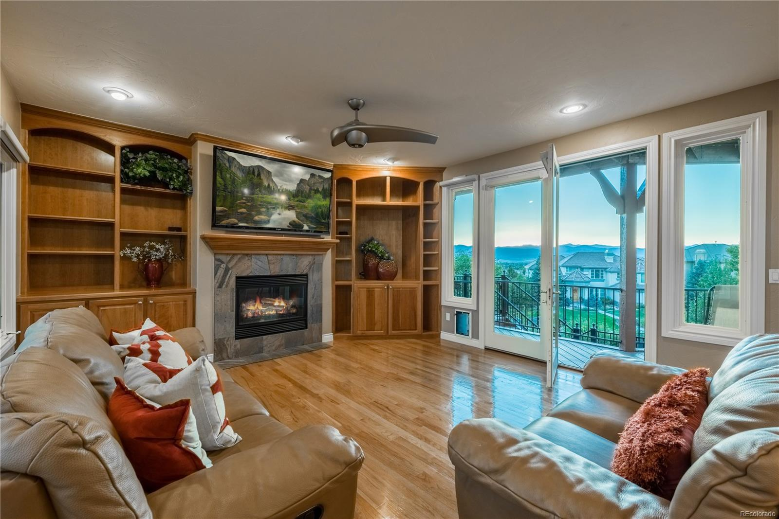 Cozy family room walks out to deck to enjoy the beautiful sunsets.