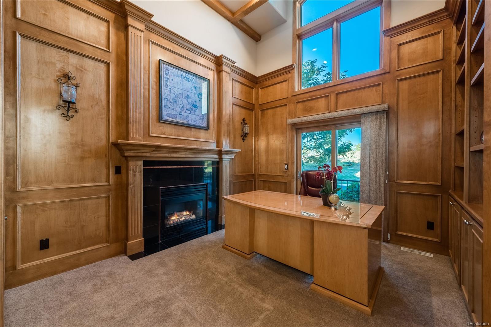 Main floor study with beautiful custom wood work.