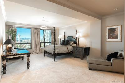 Balcony off master suite offers a perfect view of the Pepsi center, mountains by day and city lights by night.