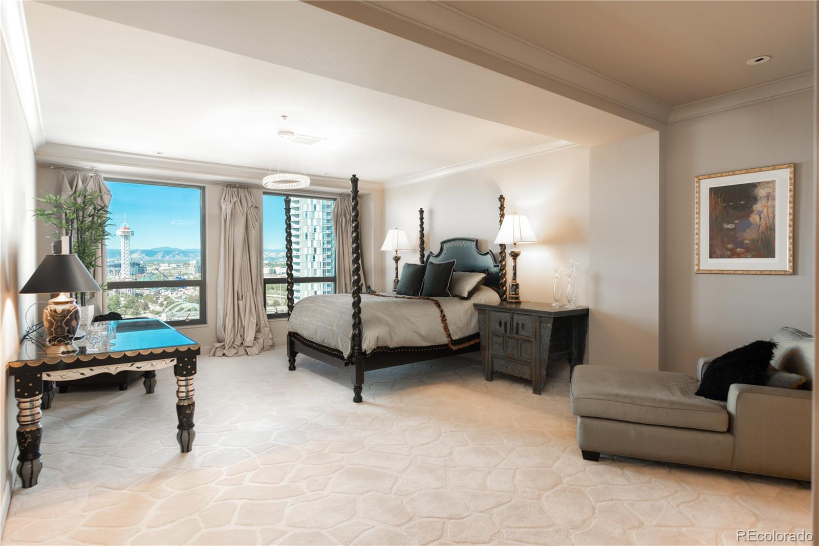 Balcony off master suite offers a perfect view of the Pepsi center, mountains by