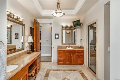 Master bath with steam shower, his and her vanities and soaking tub.
