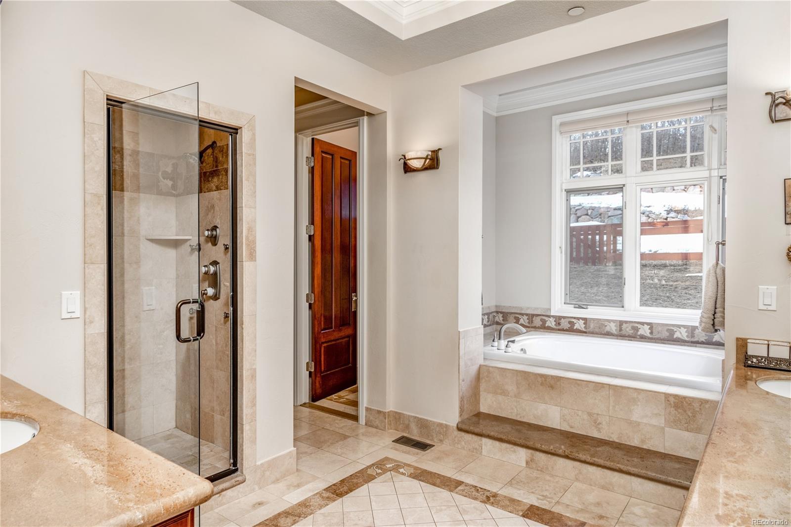 master bath boasts heated floors and European tile accents.