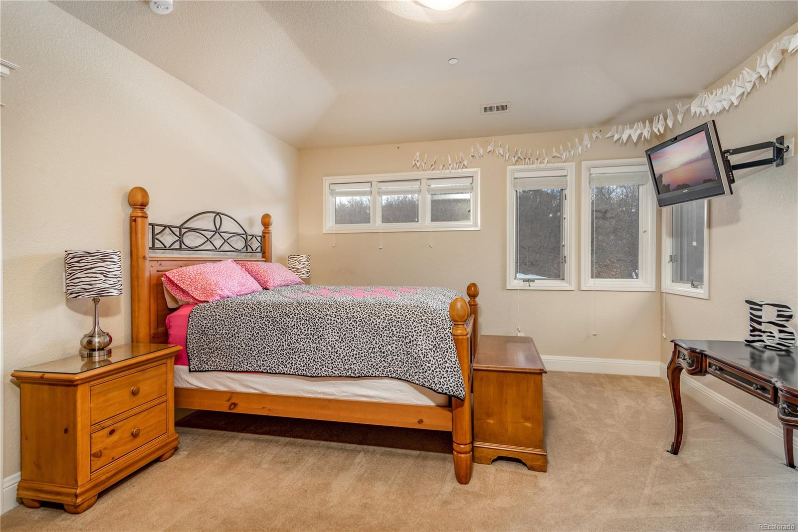 Upper level bedroom with ensuite bath and walk-in closet.
