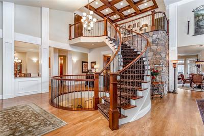 Dramatic entry with spiral staircase.