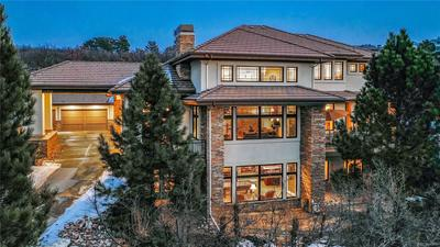 Surronded by tall pines, the oversized 4 car garage and heated upper drive.