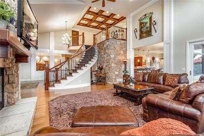 Beautiful two story great room with stone walls and fireplace.