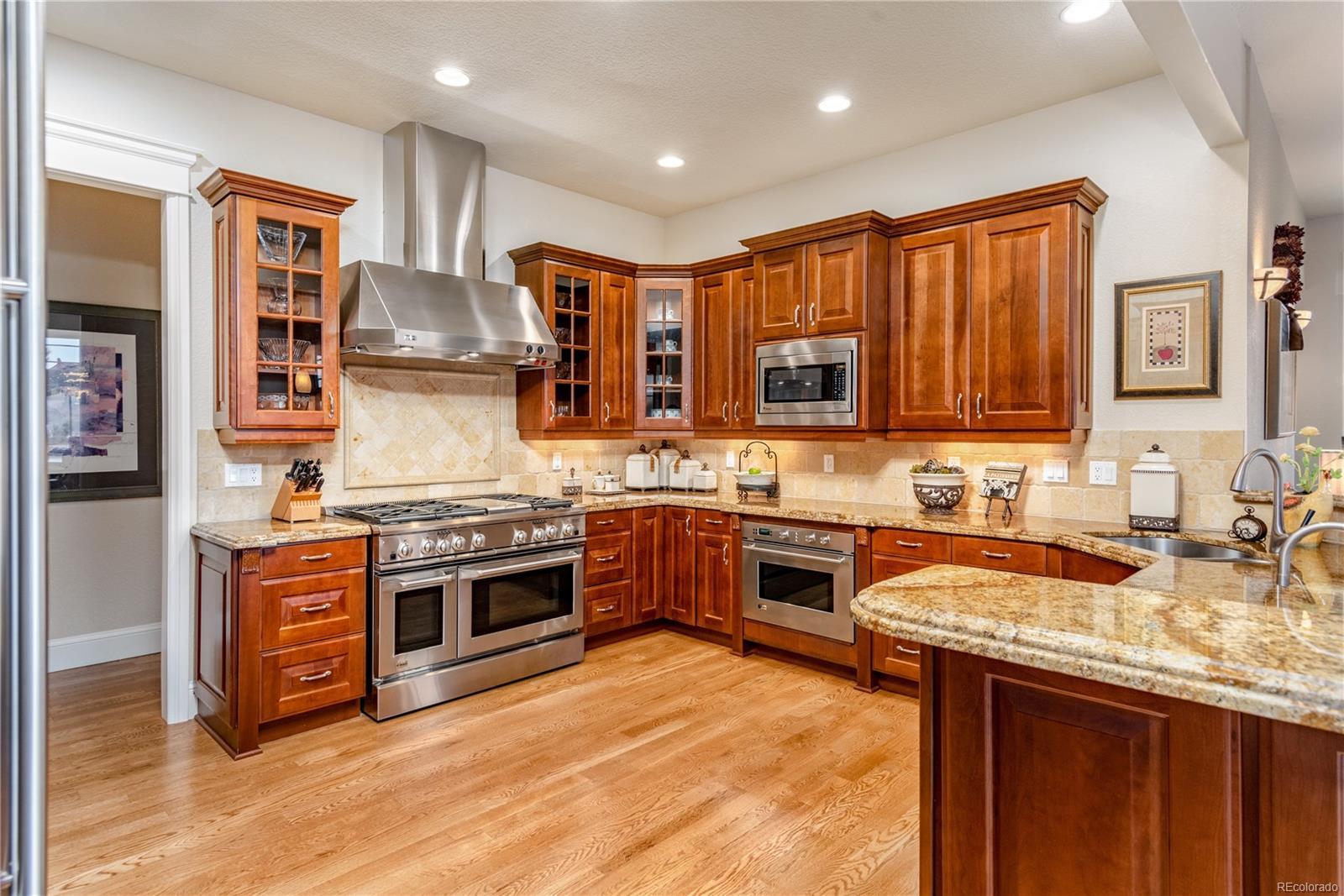 Gourmet kitchen with 48' gas range, 2 dishwashers, elegant custom cherry cabinet