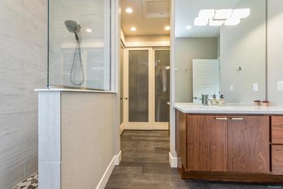 Floor to Ceiling Tile in Master Bath and Upgraded Lighting