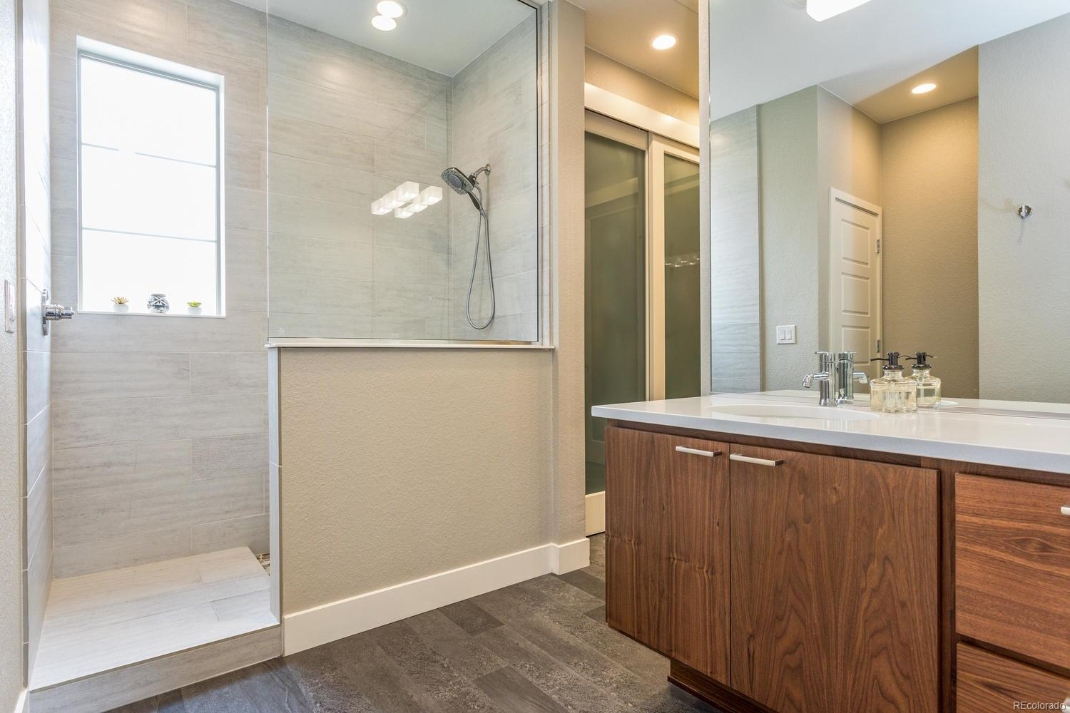 Walnut Soft Pull Cabinets and Double Sinks with Quartz Countertops!