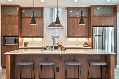 Designer Kitchen with Walnut Cabinetsand Tile Backsplash to Ceiling