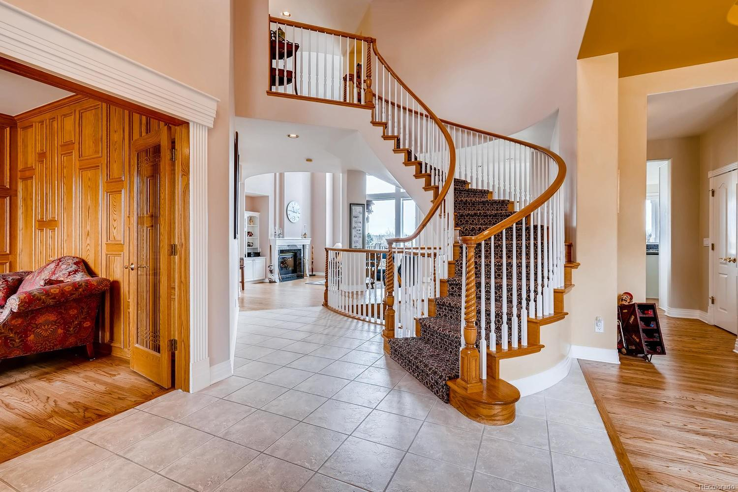 Foyer - Spiral Staircase to upper level and walkout basement