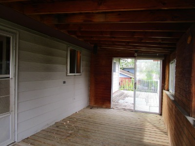 Covered deck leads to the uncovered deck