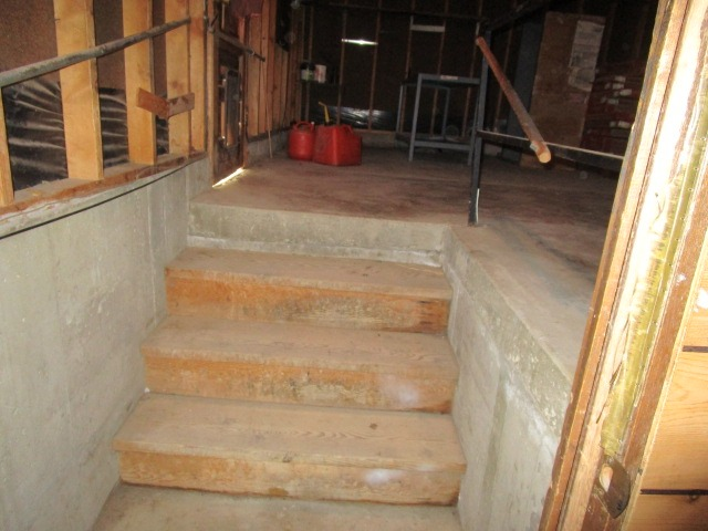 Stairs leading to the garage