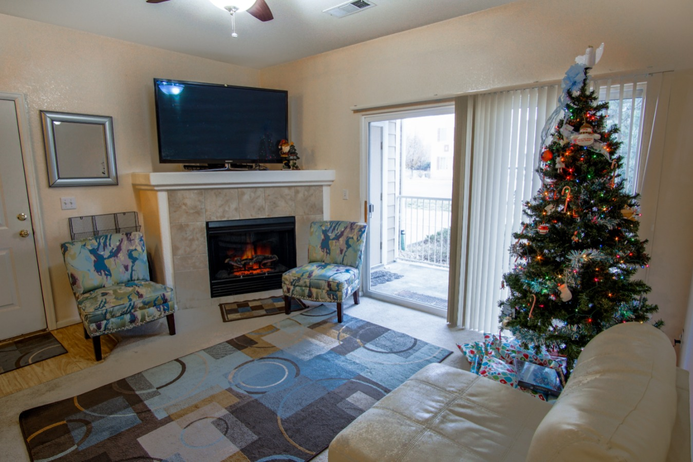 Family room with fireplace and access to the patio