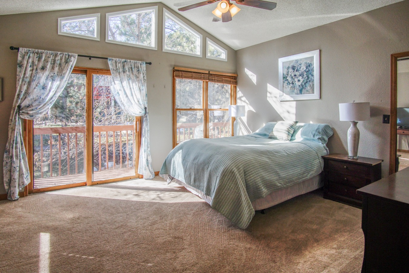 Sunny master bedroom with private deck