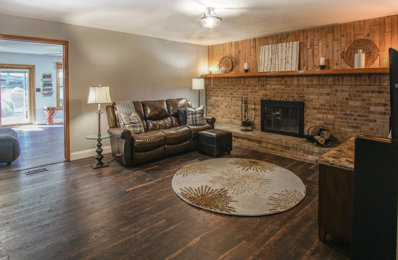 Family room has wood burning fireplace