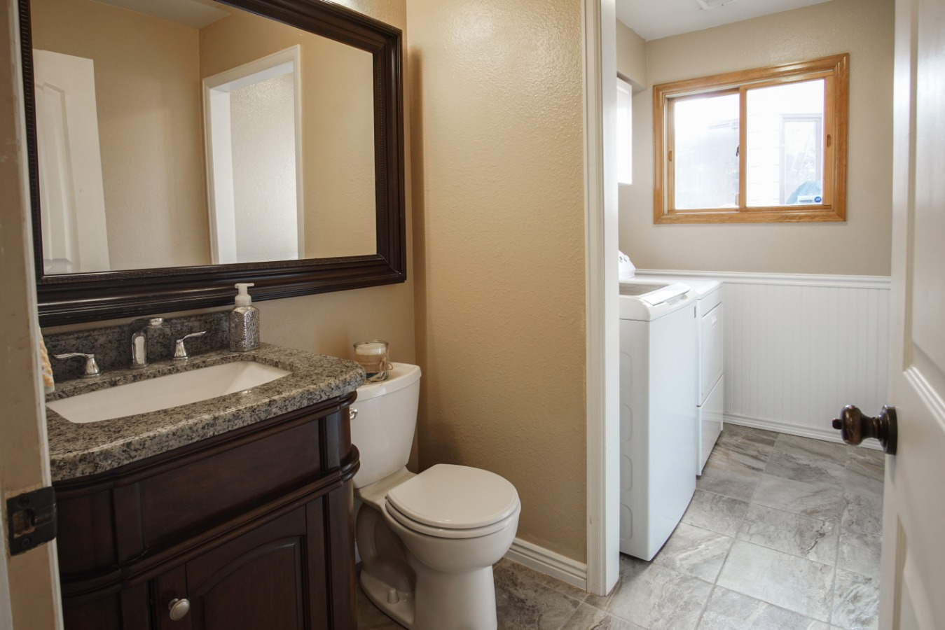 Powder room and laundry when entering from garage